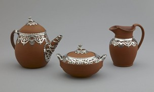 silver covered earthenware